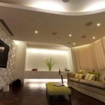 curvy-false-ceiling-design-of-plasterboard-for-living-room-with-ceiling-lights